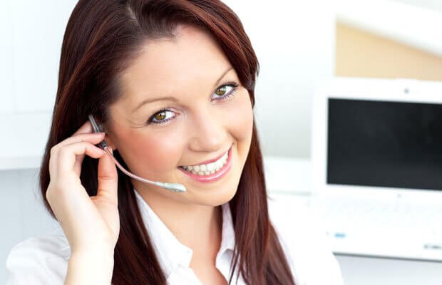 Technical support worker with headset taking a customer support call